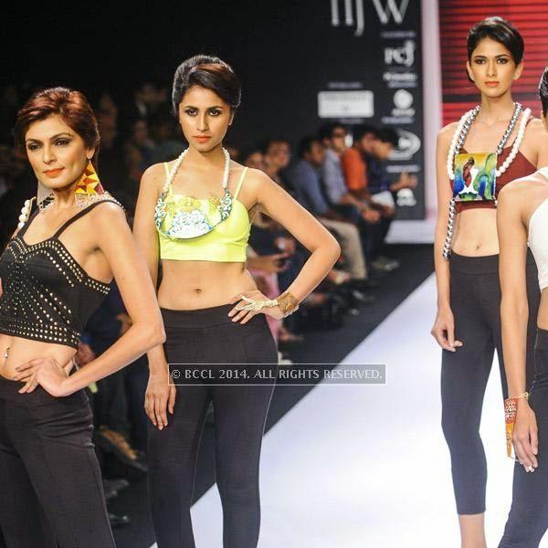 Models walk the ramp for IIGJ Mumbai on Day 1 of India International Jewellery Week (IIJW), 2014 at Grand Hyatt, Mumbai.