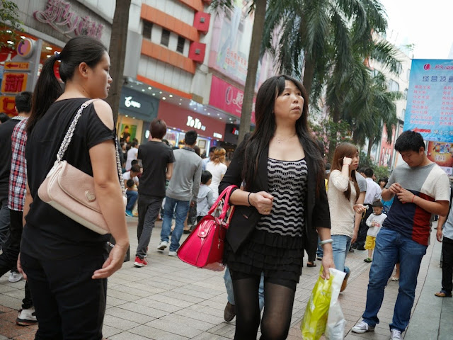 woman holding a red purse in Shenzhen