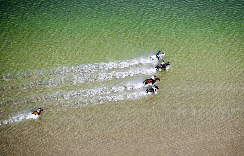 aerial view, horseback riding on Bertra Beach, Mayo. From Driving Ireland's Wild Atlantic Way
