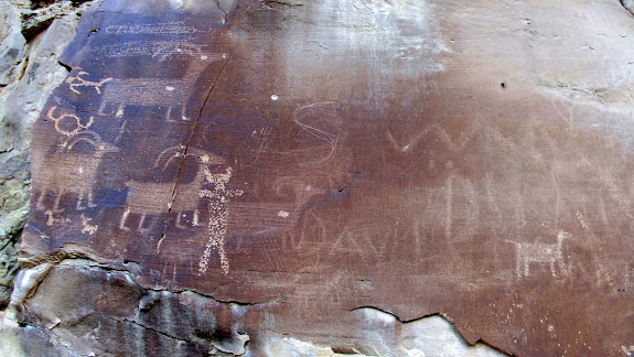 Abraded sheep overlaid with newer petroglyphs