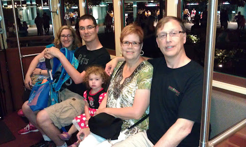 The whole family riding the trolley in California Adventure.