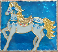 blue and white carousel horse