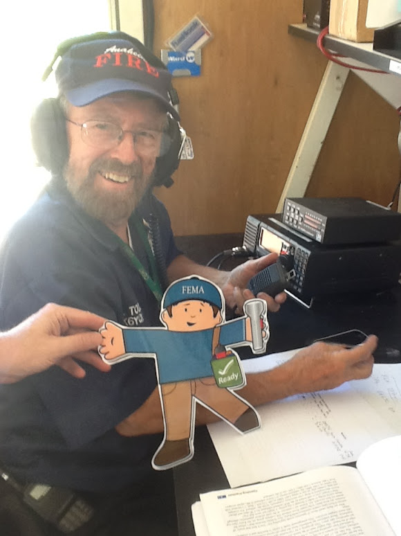 Flat Stanley poses with RACES volunteer.