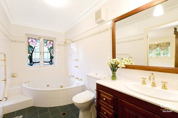 Spa bath renovation in a Federation bathroom with Art Nouveau leadlight
