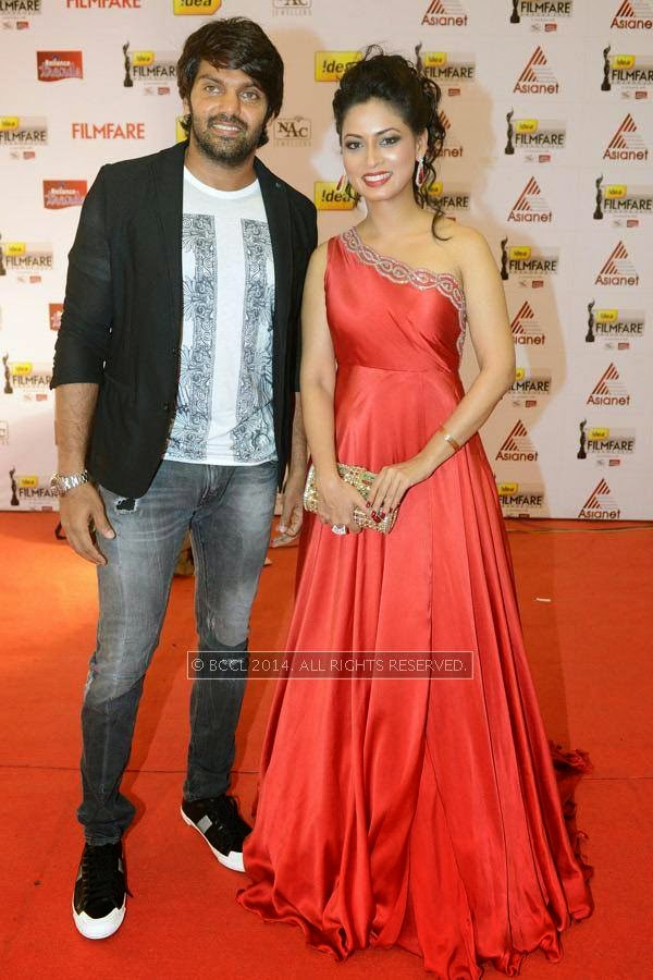 Arya and Pooja during the 61st Idea Filmfare Awards South, held at Jawaharlal Nehru Stadium in Chennai, on July 12, 2014.