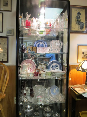 Porcelain and Glass collectibles cabinet
