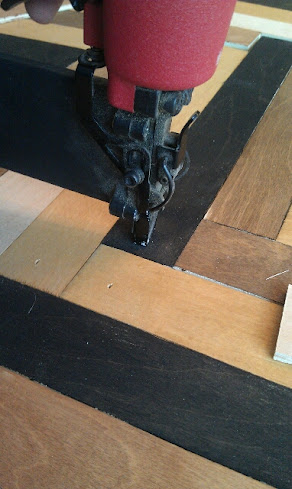 using nail gun to attach wood slats