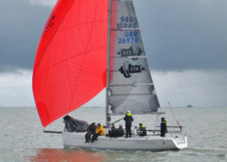 J/97 sailing under spinnaker at Warsash Spring Series