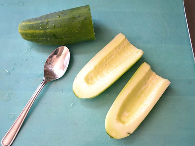 prepare cucumber (cut in half and then scoop middle out with spoon)