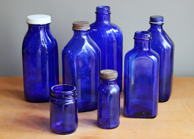 Cobalt blue medicine bottles available for rent from www.momentarilyyours.com, $1.25 each.