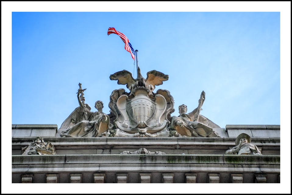 National Museum of The American Indian, architecture, historic buildings New York City, sculpture, stone work, top of the building, flag
