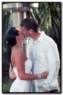 Couple Kissing in the Beach Showers