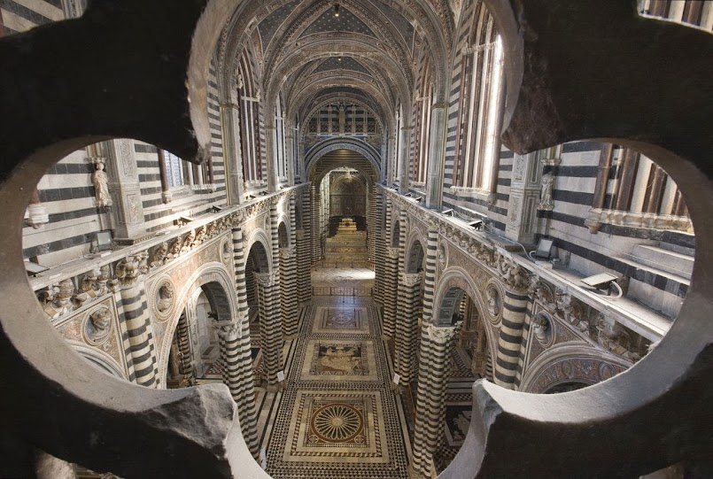 Siena cathedral: panorama view of the uncovered marble intarsia floor