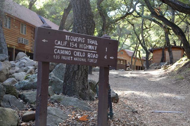 trail sign in the middle of the camp at the Circle V Ranch