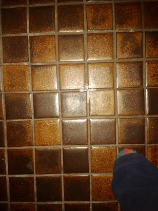 A sign of Jesus on the bathroom floor