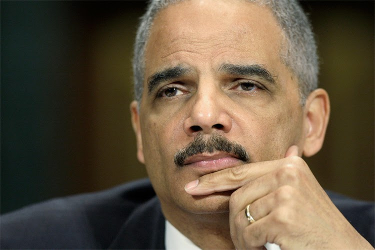 Eric Holder denounces shootings in Ferguson MO