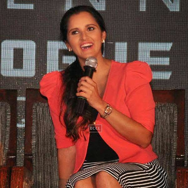 Sania Mirza is all smiles during the launch of Celkon's Millennium Vogue Q455 in Mumbai, on July 25, 2014. (Pic: Viral Bhayani)