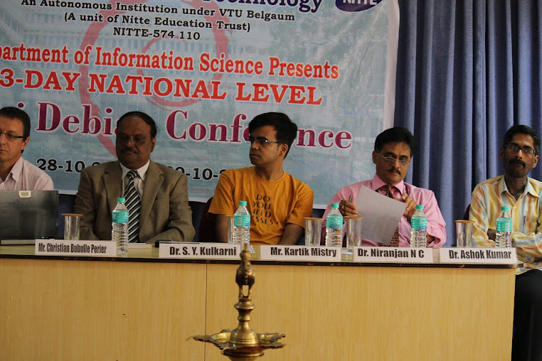 Ashokkumar during inaugaration of MiniDebconf with Christian and Kartik on stage