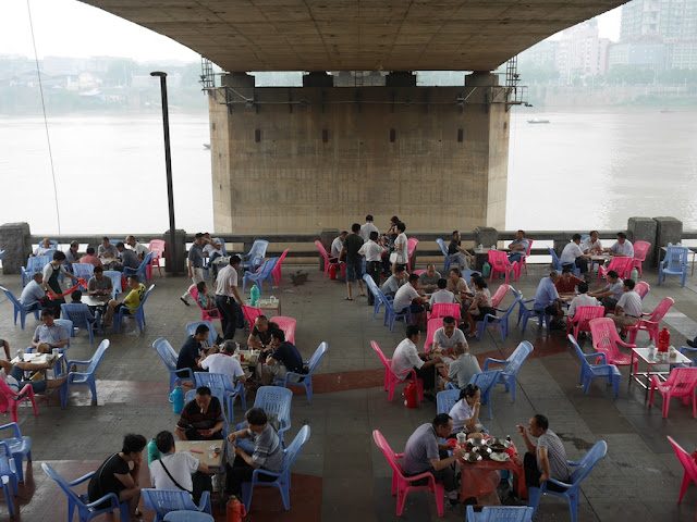 people playing cards and drinking tea under a bridge in Hengyang, Hunan, China