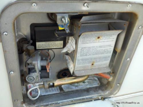 Open water heater door.