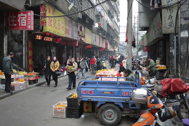people on a narrow street in Nanchang, Jiangxi