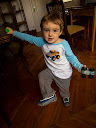 Matimu showing off some cool shoes we bought him in the market in Tana, made with the design of cars and little mini wheels on the sides.  He loves cars if you can't tell by the car in each hand, the car on his shirt and the cars on his shoes!