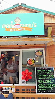 Jeff Chow, proprietar of Mama Chow's Kitchen, taking orders at Mama Chow's Kitchen for his mom's Wontons in wonton soup (pork, shrimp or chicken wontons in house broth with baby bok choy), lollipop wings (honey soy garlic glaze with jasmine rice and baby bok chow), kalua pork with garlic noodles and cayote squash, or garlic noodles that are fresh made local noodles with chayote squash and onion relish