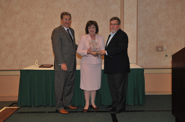 Kathleen Guarino, Vice President of Patient Care Services and Chief Nursing Officer at Mercy Hospital of Buffalo/Catholic Health System, accepts the 2011 Pinnacle Award for Quality and Patient Safety (Small Hospital category). Handing out the award are HANYS President Daniel Sisto (left) and Joseph McDonald, President and Chief Executive Officer of Catholic Health System (right).