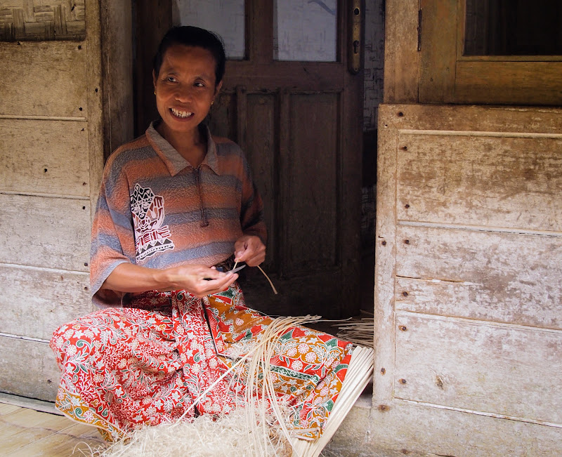Weaving baskets to sell to tourists to Kampung Naga