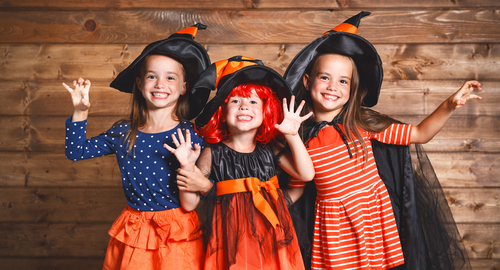 3 girls dressed as cute witches for Halloween