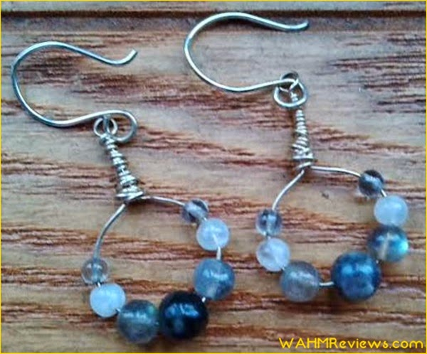 In the description of the ear rings, you will find that rainbow moonstone can help with self-discovery, and that garnet can help enhance one's vitality!