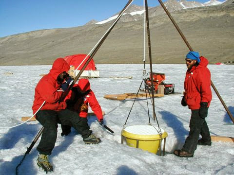 The team deploys the McLane sediment trap in Lake Bonney, 2001.