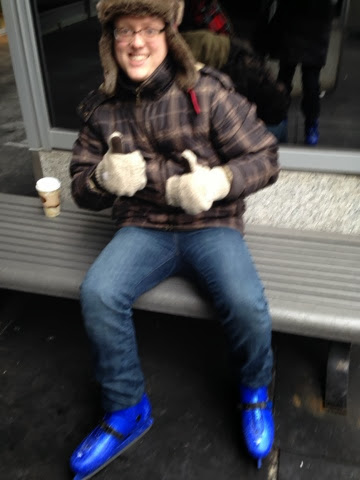 Justin donning blue ice skates