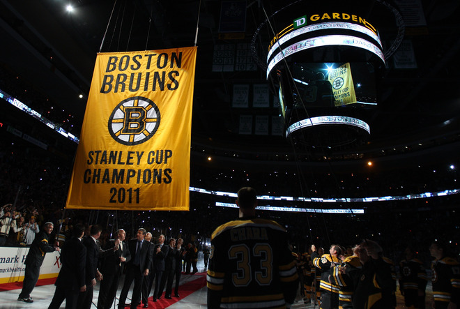 Boston Bruins raise their 2011-11 Stanley Cup Championship banner
