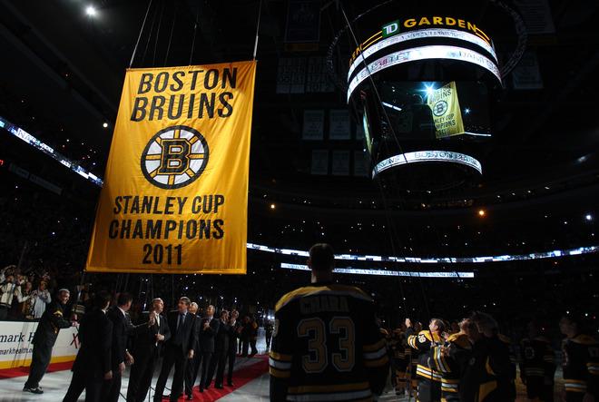 Boston Bruins raise their 2011-11 Stanley Cup Championship banner