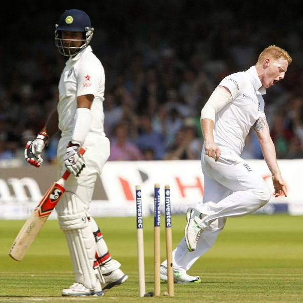 England's Ben Stokes (R) celebrates bowling India's Cheteshwar Pujara (L) for 28 runs on the first day of the second cricket Test match between England and India at Lord's cricket ground in London, on July 17, 2014.