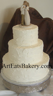 Tall tier white stucco butter cream romantic elegant wedding cake with Willow Tree Bride and Groom topper