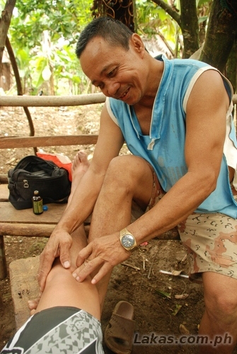 Manong Oscar doing hilot to my knee