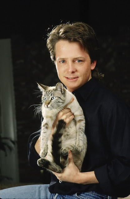 Michael J Fox posing with his cat 2