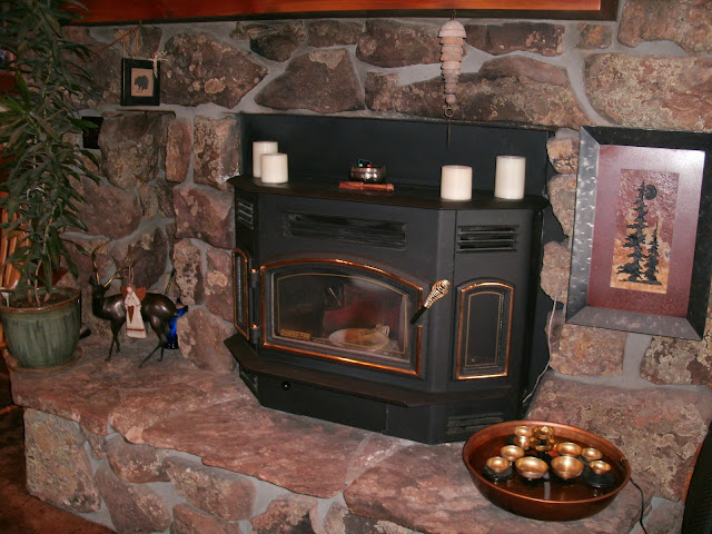 The stove pictured, we bought in 1995 and use it a lot, on a thermostat,  so, no hand starting. Wood stove came with the house, 3-story log at 8,400  ft ... - Fireplace Insert - Survivalist Forum