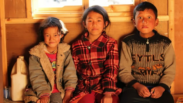 Cheerful Bumthang Kids in front of Jampey Lakhang, Bumthang, Bhutan