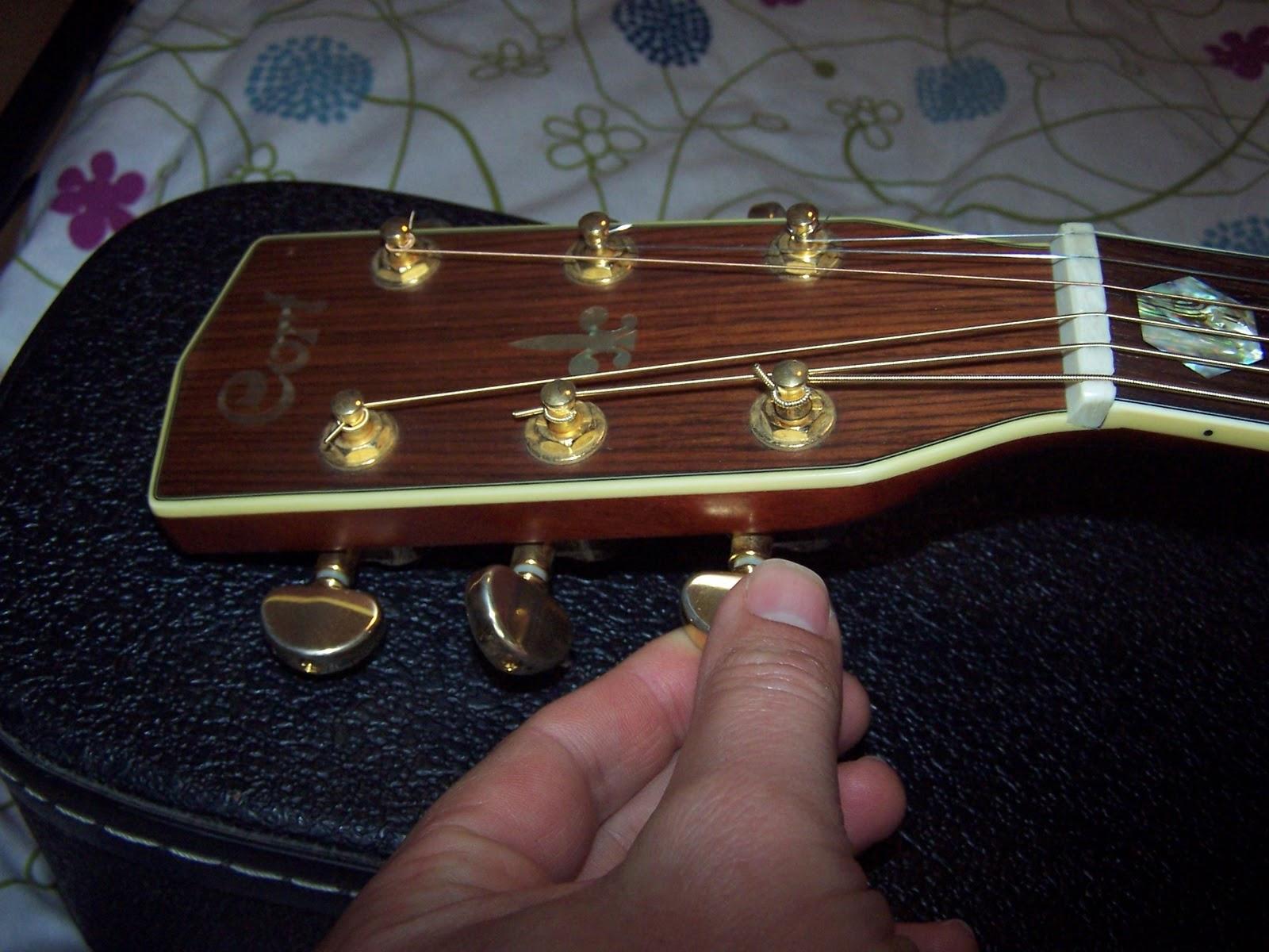 hands on diy changing strings on the acoustic guitar. Black Bedroom Furniture Sets. Home Design Ideas