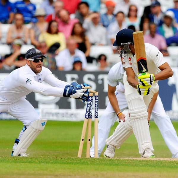England's Matt Prior, left, attempts to stump India's Ravindra Jadeja during day five of the first Test between England and India at Trent Bridge cricket ground, Nottingham, England, Sunday July 13, 2014.
