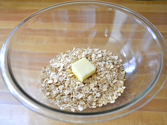 oats and butter in mixing bowl