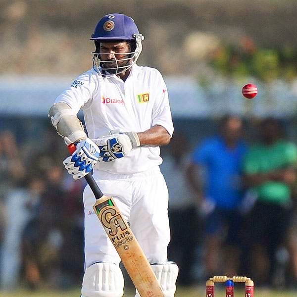 Sri Lankan batsman Upul Tharana avoids a bouncer off the bowling of South African cricketer Dale Steyn during the second day of the opening Test match between Sri Lanka and South Africa at the Galle International Cricket Stadium in Galle on July 17, 2014.