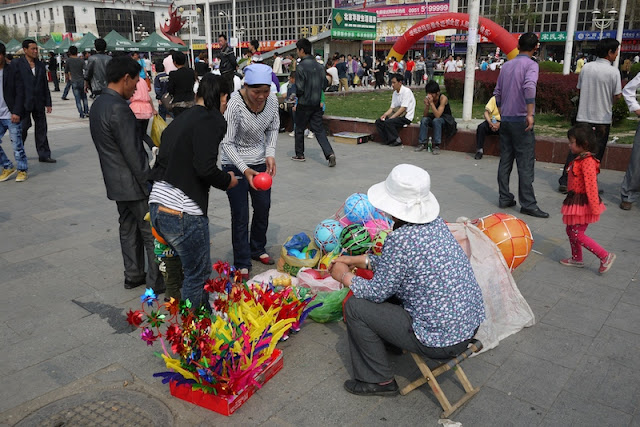 selling toys and other items for kids at Nanmen Square in Yinchuan, Ningxia, China