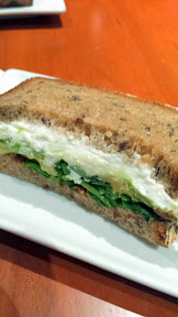 'wichCraft, in Rockefeller Cente, multigrain half sandwich with goat cheese, avocado, celery, walnut pesto and watercress, with tomato soup with basil, sherry vinegar and parmesan
