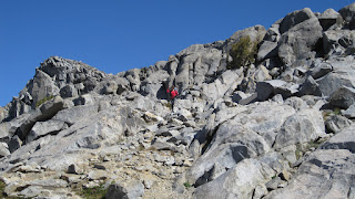 This descent was really tough. Here is M negotiating the rocks and rolls.