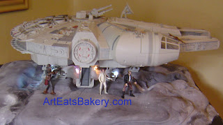Star Wars Millinium Falcon custom wedding cake design with Laya, Hans Solo and Chewy characters