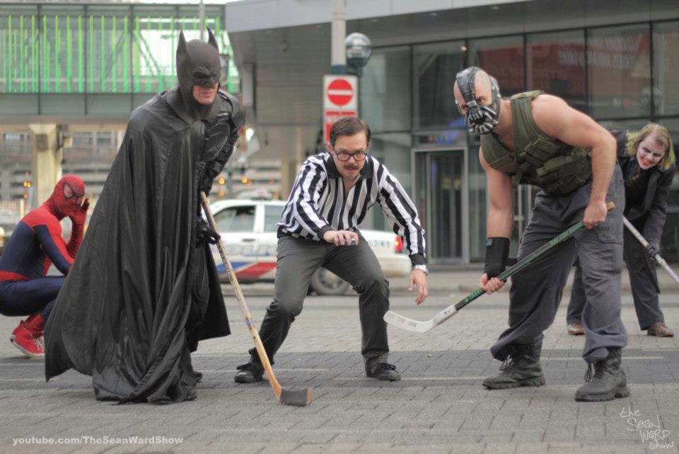 Cosplay Batman and Bane face off with Commissioner Gordon at Toronto Superhero Hockey